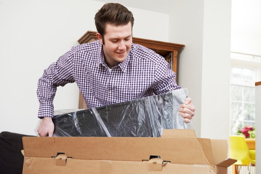 Man unpackaging TV