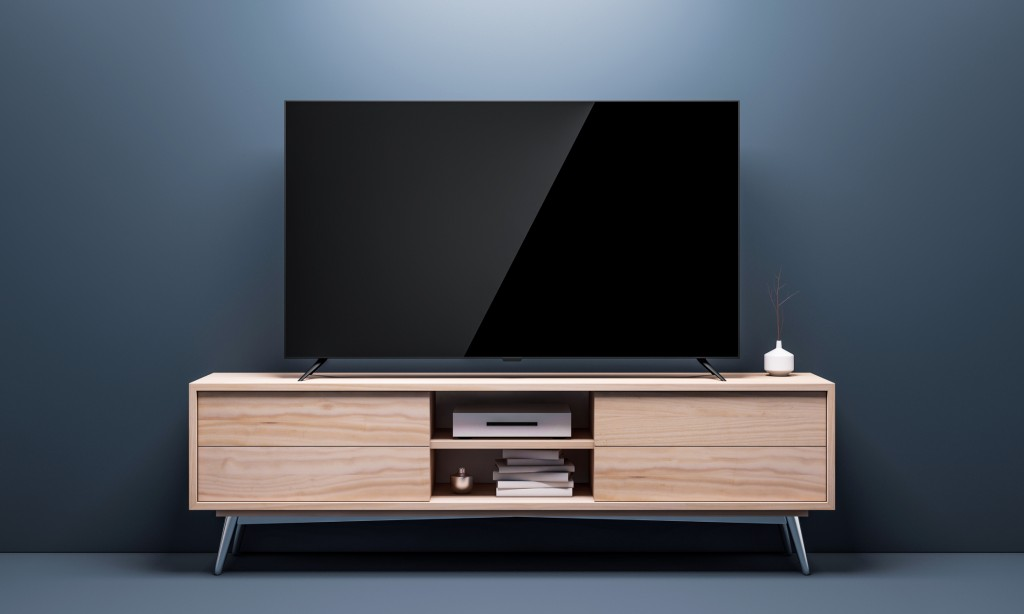 Smart Tv Mockup with black glossy screen on console in living room